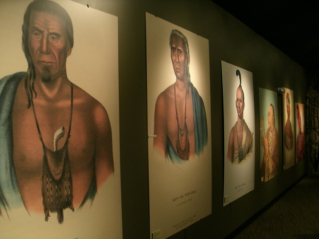 prints of paintings of Native Americans hanging in the visitor center