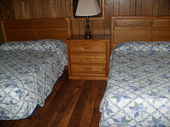 two beds inside a cabin