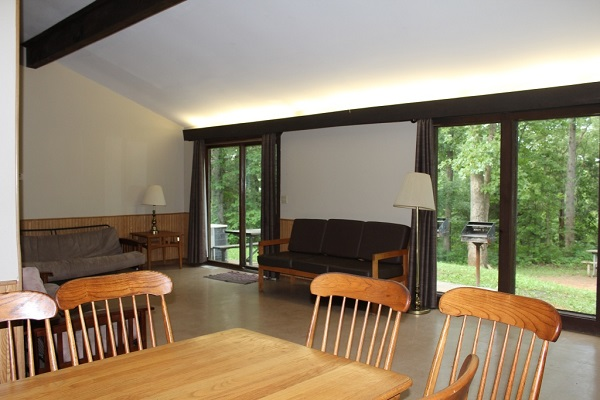 table and chairs, futon and patio doors inside the cabin