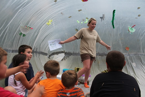 an interpreter and some kids inside an interpretive bubble