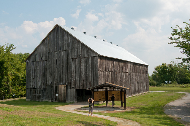 a large, wooden tobacco barn