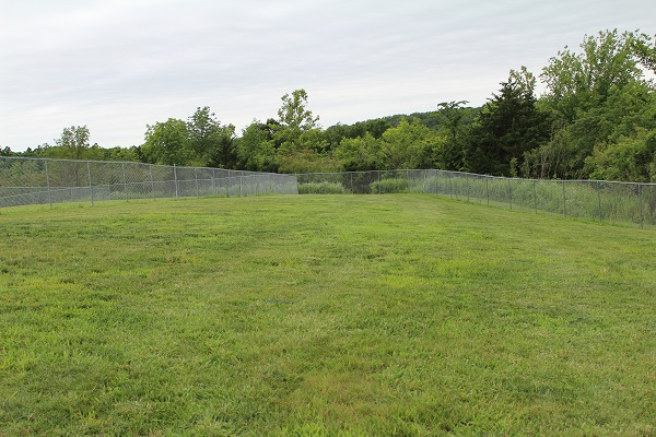 a large, open, fenced in grassy area