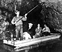 c.a. 1936 photo of people in a boat inside the cave