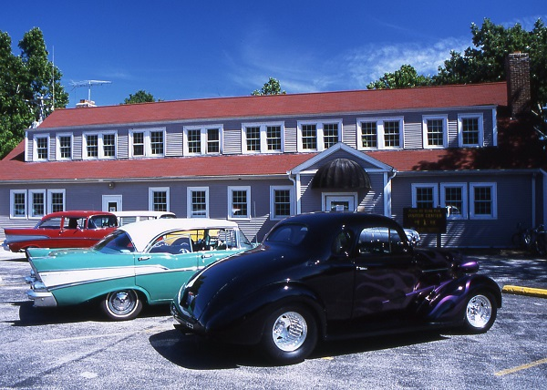 vintage cars parked in front of the visitor center