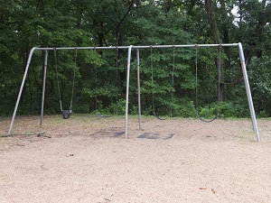 a swing set with one baby swing and two regular swings