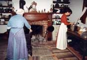 two woman working in the kitchen